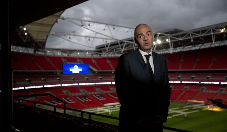 FIFA Presidential Candidate Gianni Infantino speaks during an interview with The Associated Press after he unveiled his 90 day plan that he will implement if he is elected FIFA President, at Wembley Stadium in London, Monday, Feb. 1, 2016.  (AP Photo/Matt Dunham)