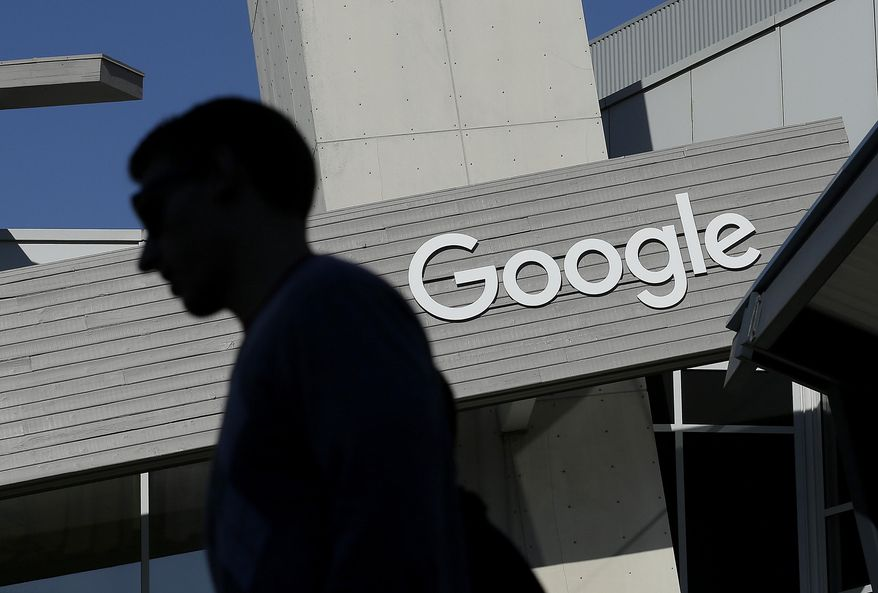 A man walks past a building on the Google campus in Mountain View, Calif. Alphabet Inc., Google's holding company, reports financial results Monday, Feb. 1, 2016.  (AP Photo/Jeff Chiu, File) ** FILE **