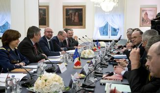 Belgian Prime Minister Charles Michel, center left, and French Interior Minister Bernard Cazeneuve, center right, participate in a meeting with other Belgian and French officials to coordinate a response to violent extremism at Chateau Val Duchesse in Brussels on Monday, Feb. 1, 2016. (AP Photo/Virginia Mayo)