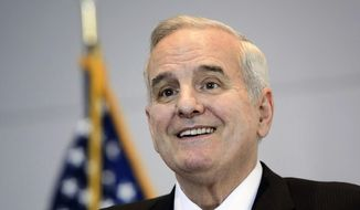 Minnesota Gov. Mark Dayton takes questions about the state's projected budget surplus in St. Paul, Minn., in this Dec. 3, 2015, file photo. Dayton was taken to a hospital for testing after fainting Sunday, Jan. 31, 2016, during an event in the Twin Cities suburb of Woodbury, his chief of staff said. (Glen Stubbe/Star Tribune via AP, File)