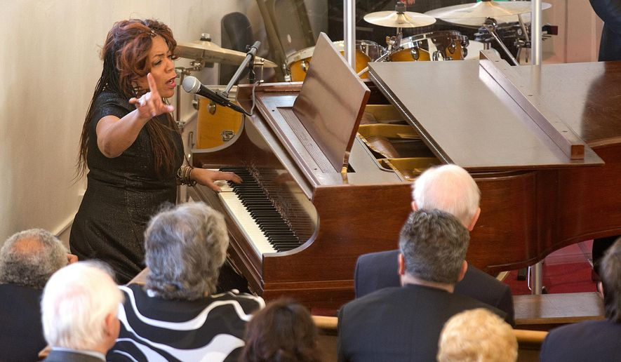 Valerie Simpson performs during a ceremony at First Baptist Church on Monday, Feb. 1, 2016, in Williamsburg, Va. The long-silent bell at the historic Williamsburg church sounded to launch the congregation's 240th anniversary throughout Black History Month. (Joe Fudge/The Daily Press via AP) MANDATORY CREDIT