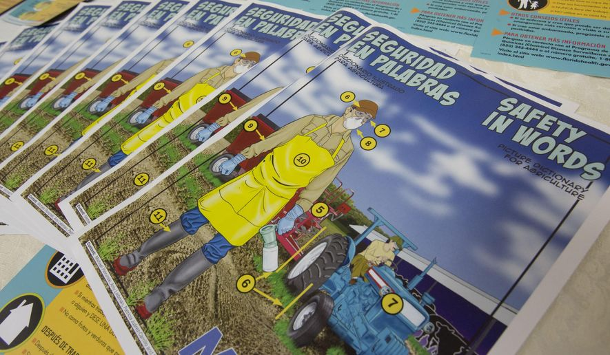 ADVANCE FOR USE WEDNESDAY, FEB. 3, 2016 AND THEREAFTER - In this Thursday, Nov. 12, 2015 photo, safety pamphlets written in both English and Spanish are displayed during a pesticide safety training class for farm supervisors in Sebring, Fla. Millions of farm workers do jobs with a high risk of exposure to toxic chemicals every day, yet a federal system of protections meant to improve safety and provide an avenue for reporting exposure is ineffective and riddled with problems, according to an Associated Press review of federal and state enforcement data and case records. (AP Photo/Wilfredo Lee)