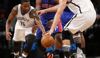 Brooklyn Nets guard Donald Sloan (15) and Brooklyn Nets center Brook Lopez (11) go after a loose ball as Detroit Pistons guard Reggie Jackson (1) defends in the first half of an NBA basketball game, Monday, Feb. 1, 2016, in New York. (AP Photo/Kathy Willens)