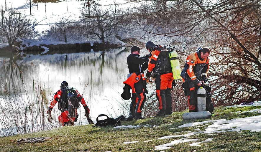 In this Jan. 31, 2016, file photo, troopers prepare to search the Duck Pond in Blacksburg, Va. The investigation continued in the death of Nicole Madison Lovell as a state police search and recovery team searched the pond for evidence on the Virginia Tech Campus. (Edmee Rodriguez/The Roanoke Times via AP)