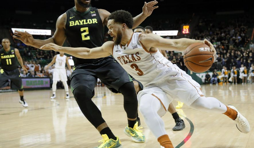 Texas guard Javan Felix (3) drives past Baylor's Rico Gathers (2) on his way to the basket in the first half of an NCAA college basketball game, Monday, Feb. 1, 2016, in Waco, Texas. (AP Photo/Tony Gutierrez)