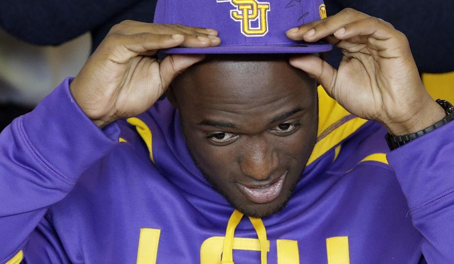 FILE - In this Wednesday, Feb. 5, 2014, file photo, St. Augustine running back Leonard Fournette adjusts his hat after signing to play football at LSU during a national signing day ceremony at St. Augustine High School in New Orleans. Fournette finished sixth in the Heisman Trophy vote in 2015 and has rushed for 2,987 yards in two seasons at LSU. There are no sure things in recruiting, but the players at the very top of the rankings often go on to distinguished college careers, with NFL success a distinct possibility as well. (David Grunfeld/NOLA.com The Times-Picayune via AP) MAGS OUT; NO SALES; USA TODAY OUT; THE BATON ROUGE ADVOCATE OUT; THE NEW ORLEANS ADVOCATE OUT; MANDATORY CREDIT