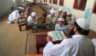 """The madrassas create their own social studies books that divide the world into Darul Islam and Darul Kufr,"" said Tariq Rahman, liberal arts dean at Beaconhouse National University near Lahore, referring to terms that mean ""land of Islam"" and ""land of disbelief."" (Associated Press)"