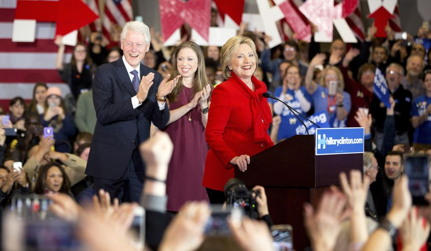 Democratic presidential candidate Hillary Clinton, accompanied by former President Bill Clinton and their daughter Chelsea Clinton speaks at her caucus night rally at Drake University in Des Moines, Iowa, Monday, Feb. 1, 2016. (AP Photo/Andrew Harnik)