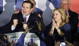 Republican presidential candidate, Sen. Ted Cruz, R-Texas, speaks during a caucus night rally as his wife Heidi listens Monday, Feb. 1, 2016, in Des Moines, Iowa. Cruz sealed a victory in the Republican Iowa caucuses, winning on the strength of his relentless campaigning and support from his party's diehard conservatives. (AP Photo/Chris Carlson)