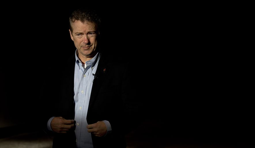Republican presidential candidate, Sen. Rand Paul, R-Ky., arrives at the Mid-America Center  to attend a rally Saturday, Jan. 30, 2016, in Council Bluffs, Iowa. (AP Photo/Jae C. Hong)