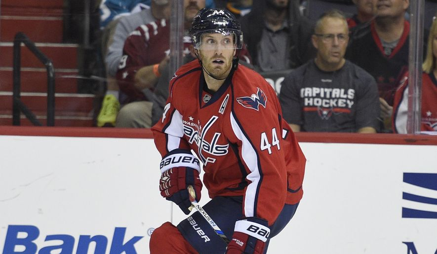 Washington Capitals defenseman Brooks Orpik (44) skates with the puck against the San Jose Sharks during the second period of an NHL hockey game, Tuesday, Oct. 13, 2015, in Washington. (AP Photo/Nick Wass)