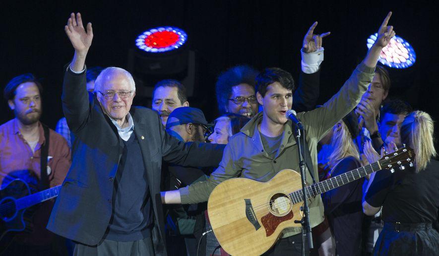 Democratic presidential candidate Sen. Bernie Sanders, I-Vt., left, and Vampire Weekend lead singer Ezra Koenig wave during a campaign rally at  the University of Iowa, Saturday, Jan. 30, 2016, in Iowa City, Iowa. (AP Photo/Evan Vucci) ** FILE **