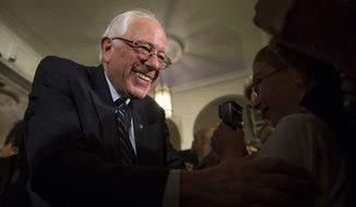 Democratic presidential candidate Sen. Bernie Sanders, I-Vt., shakes hands during a campaign rally in Davenport, Iowa, in this Jan. 29, 2016, file photo. (AP Photo/Evan Vucci)