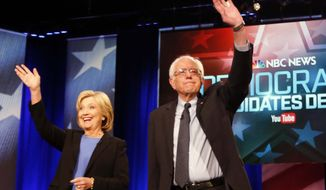 FILE - In this Jan. 17, 2016 photo, Democratic presidential candidates, Hillary Clinton and Sen. Bernie Sanders, I-Vt,  stand together before the start of the NBC, YouTube Democratic presidential debate at the Gaillard Center in Charleston, S.C.  The Democratic presidential campaigns of Hillary Clinton and Bernie Sanders reached an agreement in principle on Saturday to hold another presidential debate next week in New Hampshire and three more later this spring.  (AP Photo/Mic Smith)