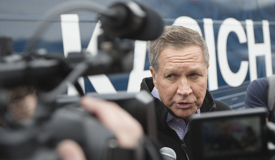 Republican presidential candidate Ohio Gov. John Kasich speaks to the media outside of a campaign stop at the Historical Society of Cheshire County, Saturday, Jan. 30, 2016, in Keene, N.H. (AP Photo/John Minchillo)