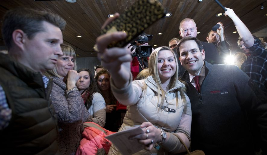 Republican presidential candidate, Sen. Marco Rubio, R-Fla., poses for a photo during a campaign event at Iowa State University, Saturday, Jan. 30, 2016, in Ames, Iowa. (AP Photo/Mary Altaffer)