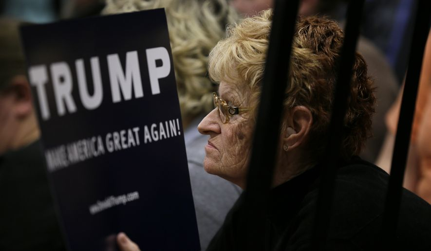 An audience member listens as Republican presidential candidate Donald Trump speaks during a campaign rally at Clinton Middle School, Saturday, Jan. 30, 2016, in Clinton, Iowa. (AP Photo/Charlie Neibergall) ** FILE **