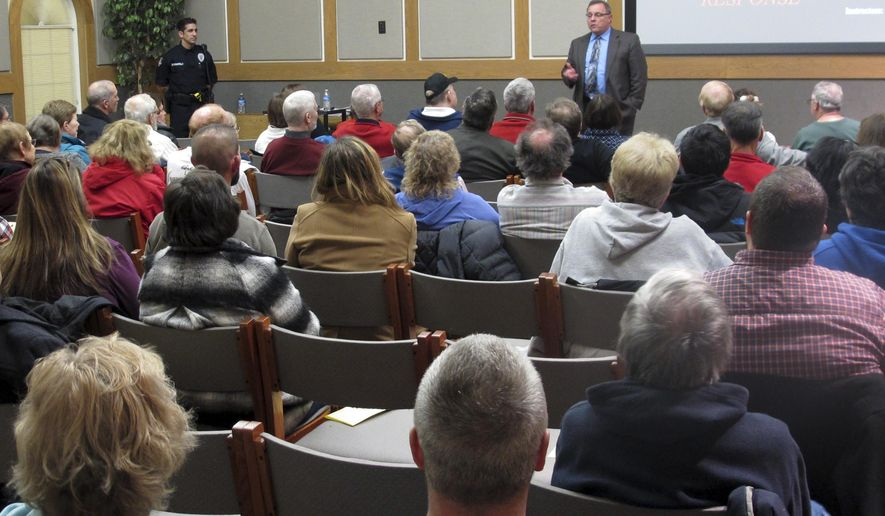 In this Thursday, Jan. 28, 2016 photo, Westerville police chief Joe Morbitzer welcomes community members to a first-ever class about reacting to and surviving an active shooter, while speaking in Westerville, Ohio. Morbitzer says people today understand threats are real and could happen where they live. (AP Photo/Andrew Welsh-Huggins)