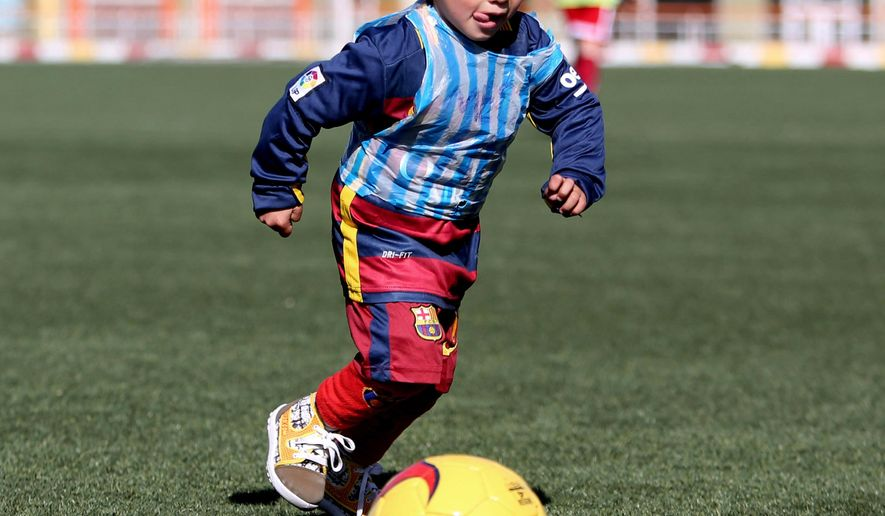 3c3e59d58 Messi sends signed shirts to young Afghan boy - Washington Times