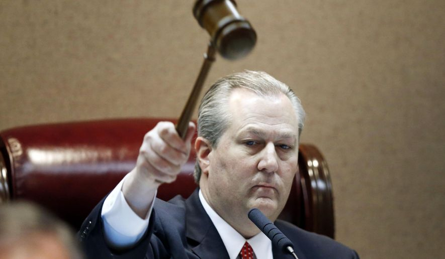 Rep. Mike Hubbard of Auburn, Ala., pounds the gavel to signify the beginning of Alabama legislation's opening, Tuesday, Feb. 2, 2016, in Montgomery, Ala. (AP Photo/Brynn Anderson)