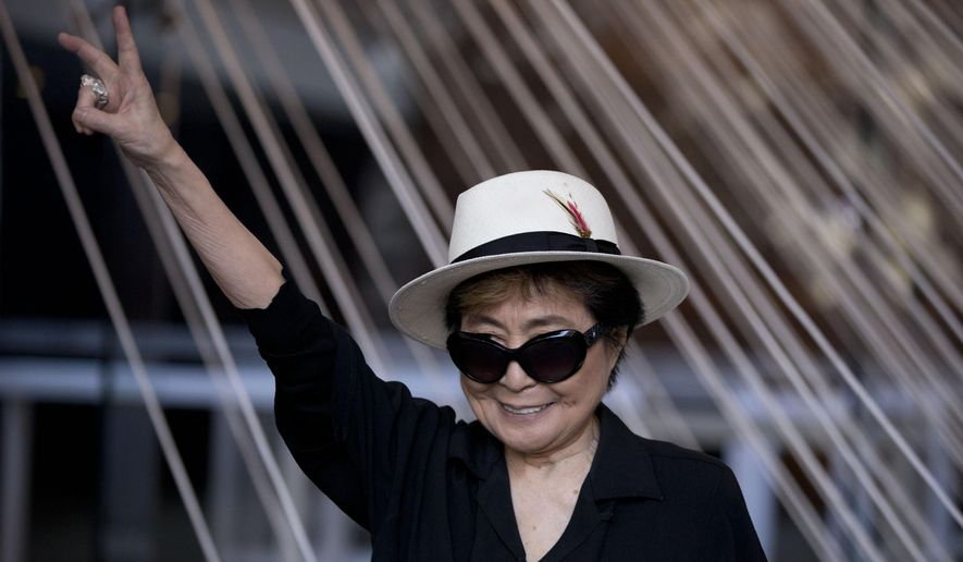 "Yoko Ono poses for photographers in front of a work entitled ""Morning Beams/River Bed,"" at a press event to mark the opening of her exhibiition ""Land of Hope"" at the Museum of Memory and Tolerance in Mexico City, Tuesday, Feb. 2, 2016. (AP Photo/Rebecca Blackwell)"
