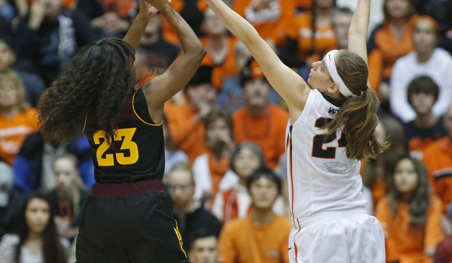 Arizona State's Elisha Davis, left, has her shot blocked by Oregon State's Sydney Wiese, right, in the first half of an NCAA college basketball game in Corvallis, Ore., on Monday, Feb. 1, 2016. (AP Photo/Timothy J. Gonzalez)