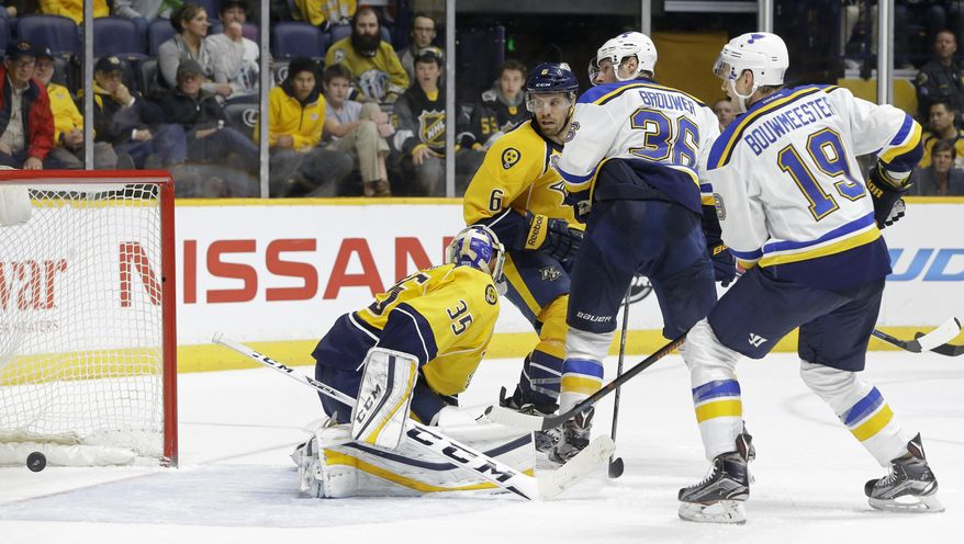 St. Louis Blues right wing Troy Brouwer (36) watches as his tip-in gets past Nashville Predators goalie Pekka Rinne (35), of Finland, for a goal in the third period of an NHL hockey game Tuesday, Feb. 2, 2016, in Nashville, Tenn. The goal gave the Blues a 1-0 win. Looking on are Blues' defenseman Jay Bouwmeester (19) and Predators defenseman Shea Weber (6). (AP Photo/Mark Humphrey)