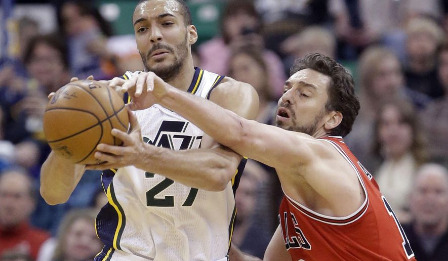 Chicago Bulls center Pau Gasol, right, tries to take the ball away from Utah Jazz center Rudy Gobert during the first quarter in an NBA basketball game Monday, Feb. 1, 2016, in Salt Lake City. (AP Photo/Rick Bowmer)