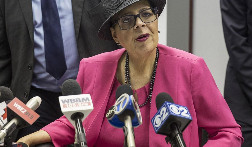 "FILE - In this June 25, 2015 file photo, Chicago Teachers Union (CTU) President Karen Lewis, speaks at a news conference in Chicago. Chicago school officials said Tuesday Feb. 2, 2016, they're ready to cut $100 million from school budgets and force teachers to pay more pension costs after the teachers' union rejected the latest offer in contentious contract negotiations that have lasted over a year. Lewis shot back, calling the district's announcement the ""latest act of war"" and saying teachers in the nation's third-largest district would protest this week. (Rich Hein/Sun-Times via AP, File)"