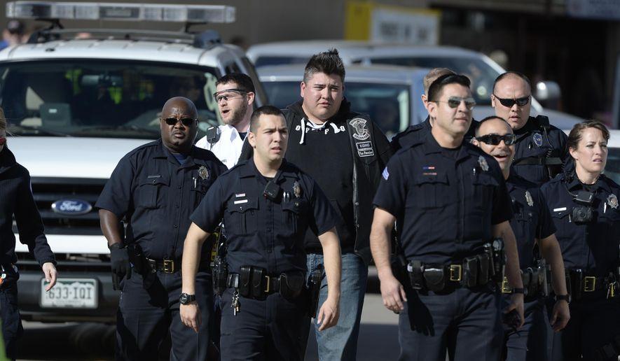 Police respond to the Denver Coliseum on Saturday, Jan. 30, 2016 in Denver. (Andy Cross/The Denver Post via AP)