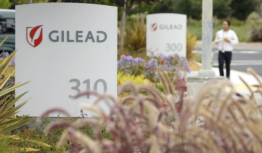 FILE - In this July 9, 2015, file photo, a man walks outside the headquarters of Gilead Sciences in Foster City, Calif. Gilead Sciences reports quarterly financial results on Tuesday, Feb. 2, 2016. (AP Photo/Eric Risberg, File)