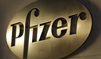 FILE - In this Monday, Nov. 23, 2015, file photo, the Pfizer logo is displayed at world headquarters, in New York. Pfizer reports financial results, Tuesday, Feb. 2, 2016. (AP Photo/Mark Lennihan, File)