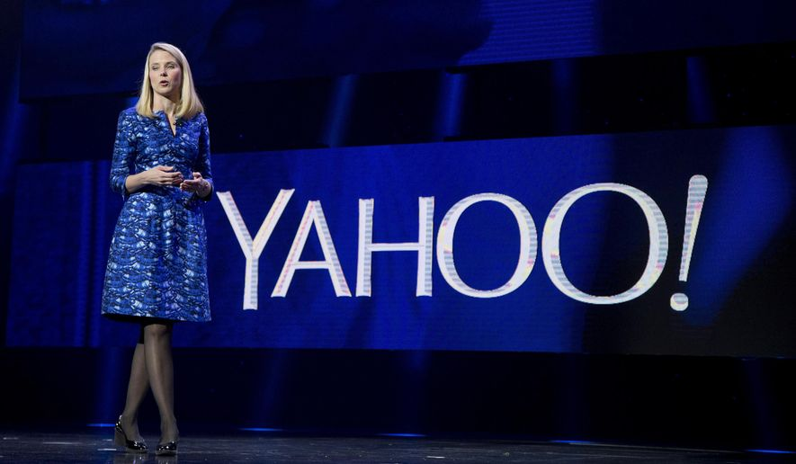 In this Jan. 7, 2014, file photo, Yahoo president and CEO Marissa Mayer speaks during the International Consumer Electronics Show in Las Vegas. Yahoo reports financial earnings on Tuesday, Feb. 2, 2016.