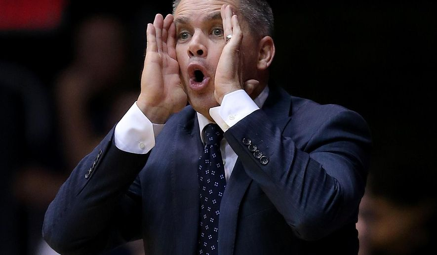 Butler head coach Chris Holtmann calls out a play during the first half of an NCAA college basketball game against Georgetown Tuesday, Feb 2, 2016, in Indianapolis. (Matt Kryger/The Indianapolis Star via AP)  NO SALES; MANDATORY CREDIT