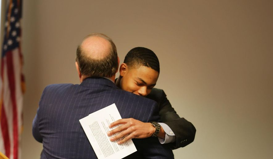 Detroit Mayor Mike Duggan hugs Tavon Stearns, an Osborn High School senior who serves as the master of ceremonies and was a Grow Detroit's Young Talent participant, at the Detroit Regional Chamber Tuesday, Feb. 2, 2016, where the mayor announces an expansion of the city's summer youth employment program. Stearns worked in the Mayor's office last summer and will attend the University of Michigan in the fall.  (Regina H. Boone/Detroit Free Press via AP)  DETROIT NEWS OUT; TV OUT; MAGS OUT; NO SALES; MANDATORY CREDIT DETROIT FREE PRESS