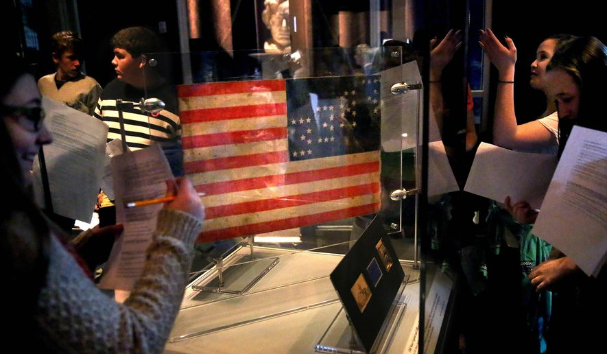 FILE - In this Thursday, April 2, 2015 file photo, a 35-star American flag that flew from Daniel Bower's sandwich cart during the Springfield funeral of Abraham Lincoln is displayed at the Abraham Lincoln Presidential Library and Museum in Springfield, Ill. Attendance to Illinois' state-administered historic sites fell 7 percent last year. That's despite commemorations of the 150th anniversaries of the end of the Civil War and the 16th president's death. (AP Photo/The State Journal-Register, David Spencer, File)