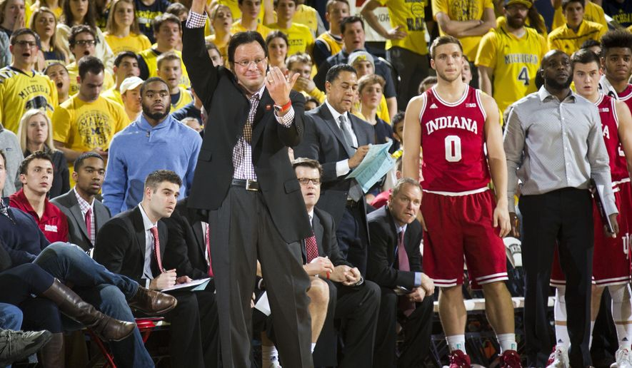 Indiana head coach Tom Crean, front left, gestures to his players on the court from beside his bench, including forward Max Bielfeldt (0), in the first half of an NCAA college basketball game against Michigan at Crisler Center in Ann Arbor, Mich., Tuesday, Feb. 2, 2016. (AP Photo/Tony Ding)