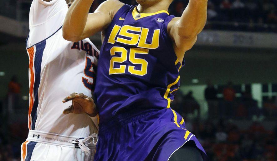 LSU's Ben Simmons shoots around Auburn's Cinmeon Bowers during the first half of an NCAA college basketball game on Tuesday, Feb. 2, 2016  in Auburn, Ala. LSU won 80-68.(Todd J. Van Emst/Opelika-Auburn News via AP) MANDATORY CREDIT