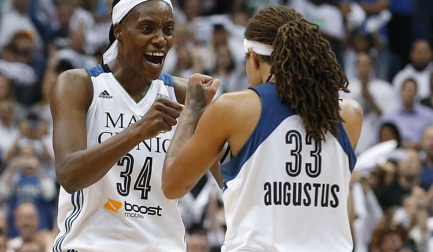 FILE - In this Oct. 14, 2015, file photo, Minnesota Lynx center Sylvia Fowles (34) celebrates with Seimone Augustus (33) after beating the Indiana Fever 69-52 in Game 5 of the WNBA basketball finals in Minneapolis. The Lynx have re-signed Fowles, the most valuable player of the WNBA finals, on Tueday, Feb. 2, 2016. (AP Photo/Jim Mone, File)
