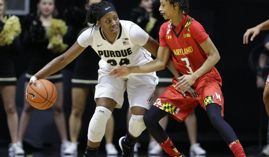 Purdue guard Andreona Keys (24) drivers on Maryland guard Brene Moseley (3) during the first half of an NCAA college basketball game in West Lafayette, Ind., Tuesday, Feb. 2, 2016. (AP Photo/Michael Conroy)