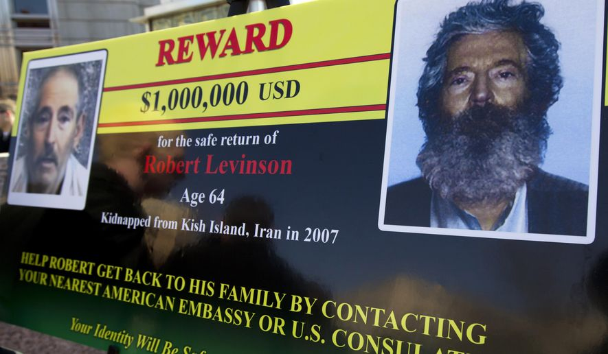FILE - In this March 6, 2012, file photo, an FBI poster showing a composite image of  former FBI agent Robert Levinson, right, of how he would look like after then-five years in captivity, and an image, left, taken from the video, released by his kidnappers in Washington during a news conference. The FBI has launched a Facebook page in Farsi to solicit tips on the whereabouts of Levinson who went missing in Iran nine years ago. (AP Photo/Manuel Balce Ceneta, File)
