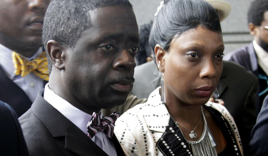 FILE- In this June 13, 2012, file photo, the parents of Ramarley Graham, Constance Malcolm, right, and Frank Graham, walk to make a statement to the media outside the courthouse in New York. The parents of Ramarley Graham, an unarmed black teenager killed by a white New York City police officer, have written a letter to the mayor saying the city has waited too long to fire the officer. Ramarley Graham was shot four years ago Tuesday, Feb. 2, 2016, in the bathroom of his Bronx home. (AP Photo/Seth Wenig, File)