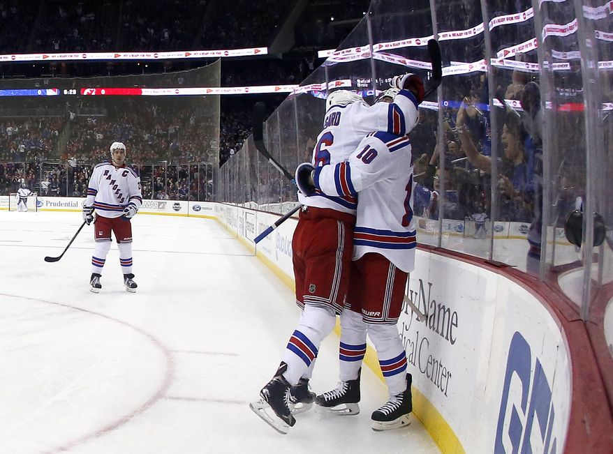 New York Rangers center J.T. Miller (10) and center Derick Brassard (16) celebrate Miller's goal against the New Jersey Devils during the first period of an NHL hockey game, Tuesday, Feb. 2, 2016, in Newark, N.J. (AP Photo/Julio Cortez)