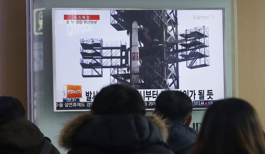 "South Koreans watch a TV news program with a file footage about North Korea's rocket launch plans, at Seoul Railway Station in Seoul, South Korea, Wednesday, Feb. 3, 2016. South Korea warned on Wednesday of ""searing"" consequences if North Korea doesn't abandon plans to launch a long-range rocket that critics call a banned test of ballistic missile technology.(AP Photo/Ahn Young-joon)"
