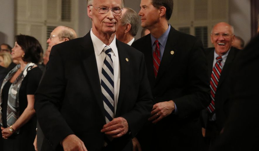 Alabama Gov. Robert Bentley walks towards the door after speaking during the annual State of the State address at the Capitol, Tuesday, Feb. 2, 2016, in Montgomery, Ala. (AP Photo/Brynn Anderson)