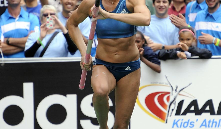 FILE -  In this June, 11, 2015, file photo, Olympic champion Jenn Suhr runs down the ramp during the Grand Prix Pole Vault & IAAF-Nestle Kids Event in Herald Square in New York.  Suhr, who turns 34 this week, broke her own indoor world record by clearing 5.03 meters (16 feet, 6 inches) on Saturday, Jan. 30, 2016, at the Golden Eagle Multi and Invitational meet in Brockport, N.Y. (AP Photo/Kathy Kmonicek)