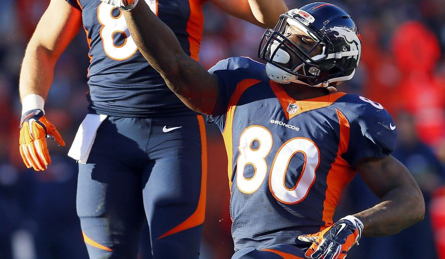FILE - In this Dec. 13, 2015, file photo, Denver Broncos tight end Vernon Davis (80) signals first down as teammate Owen Daniels (81) looks on during the first half of an NFL football game against the Oakland Raiders in Denver. He may well play a bit part at this Super Bowl. But Davis is back in the Bay Area he has called home for more than a decade. He's also ready to win a ring after coming up short three years ago with the San Francisco 49ers.  (AP Photo/Joe Mahoney, File)
