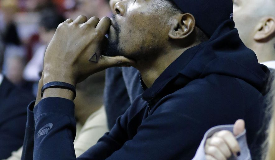 Oklahoma City Thunder forward Kevin Durant watches TCU play Oklahoma during the first half of an NCAA college basketball game in Norman, Okla., Tuesday, Feb. 2, 2016. (AP Photo/Alonzo Adams)