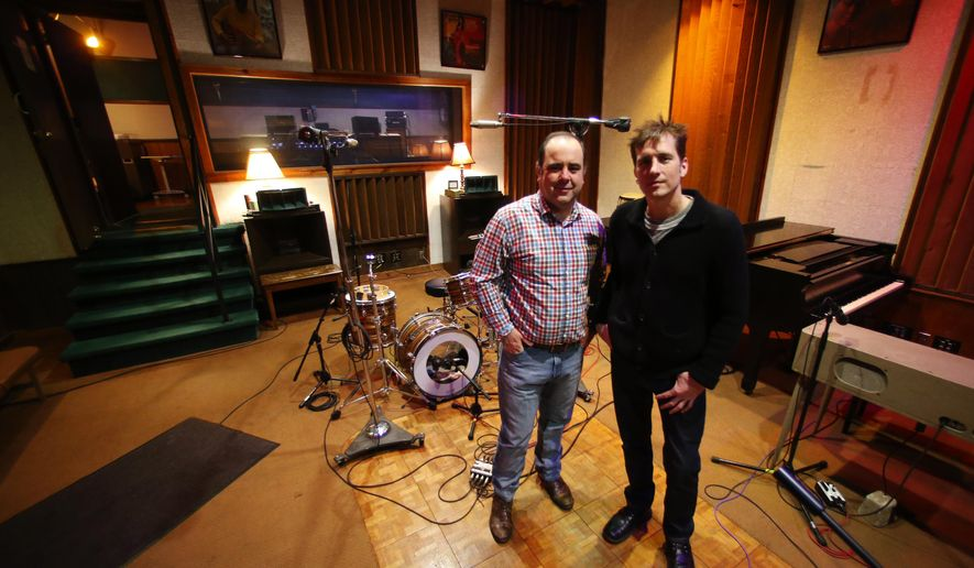 This Friday, Jan. 29, 2016 photo shows Rodney Hall, left, and Shawn Patrick at FAME Studios in Muscle Shoals, Ala. They are reinventing The Call, a contest for singer/songwriters. The competition now allows the musicians to submit their songs via video on Facebook. (Allison Carter/TimesDaily via AP)