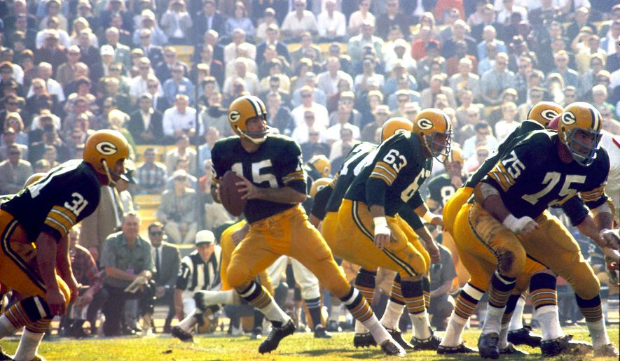 Green Bay Packers quarterback Bart Starr drops back to pass against the Kansas City Chiefs during the first Super Bowl on Jan. 15, 1967, in Los Angeles. Much has changed in the U.S. since that first game. (Associated Press)